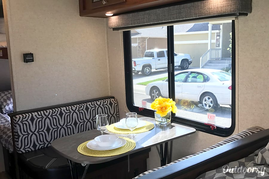 2018 Heartland Mallard M185 Loveland, CO Dining table with large window that converts into a bed