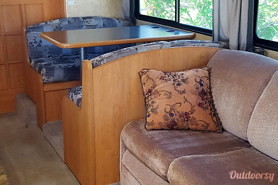 2009 Coachmen Freelander 3150SS Cortez, CO Booth and couch when RV slide is open.