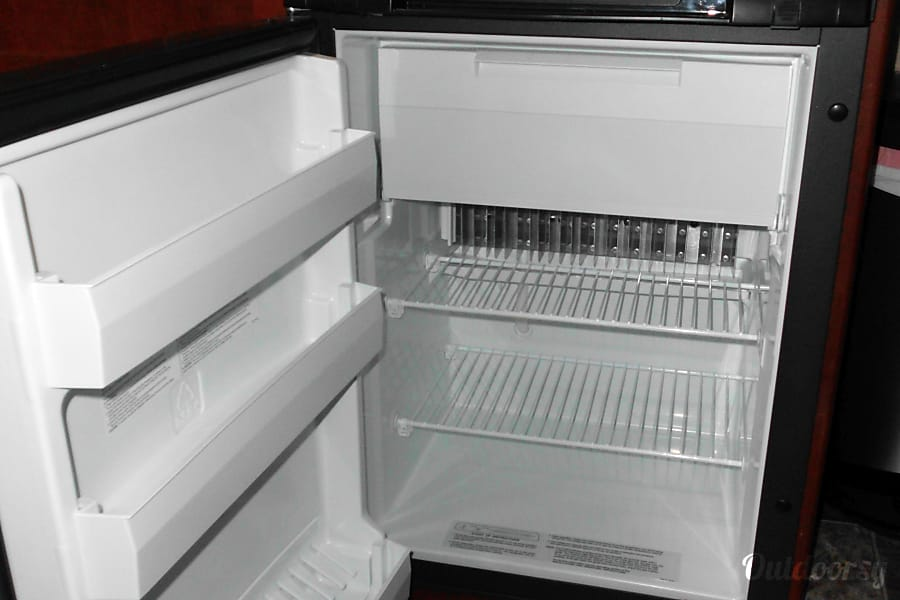 Couples Retreat Payson, AZ Half refrigerator with upper freezer section