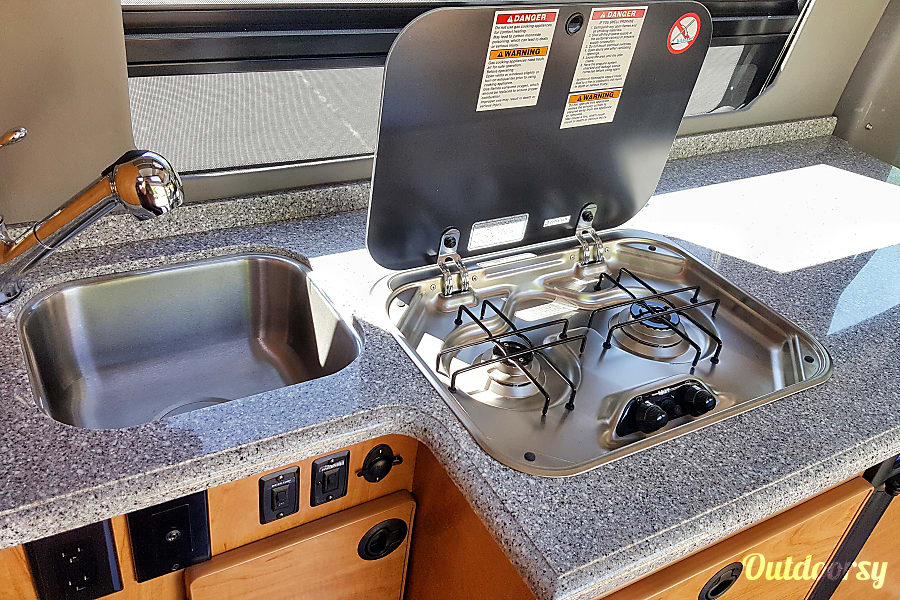 2014 Mercedes-Benz Sprinter Jackson, WY Easy to use two burner propane stove. Pressurized sink with 24 Gallon freshwater tank.