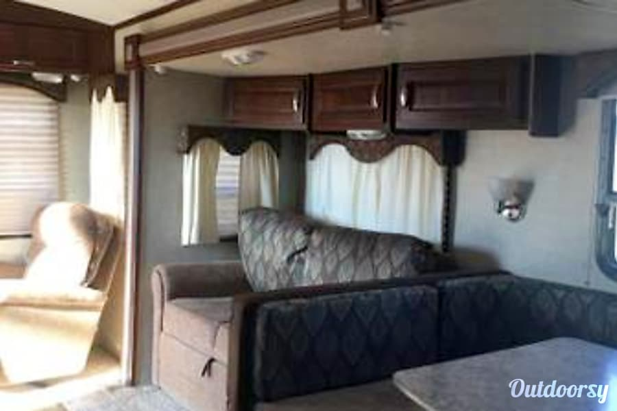 2013 Keystone Laredo 296RL. COWBOY HEAVEN !!!! Lakeland, TN Living Area with sofa bed