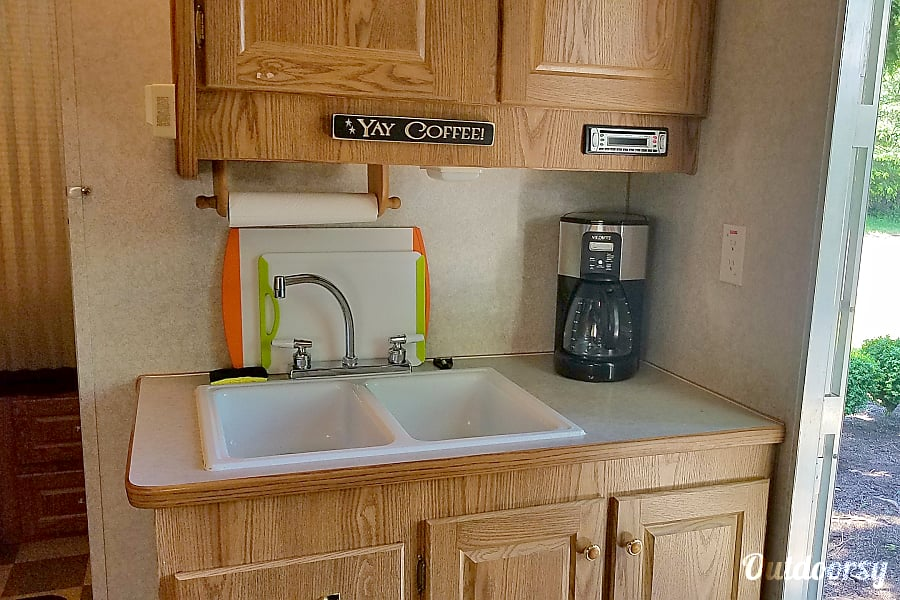 2002 Toy Hauler, Weekend Warrior Travel Trailer RV Gig Harbor, WA Double sink, coffee pot, 8 serving dishes, pots and pans. CD player with wired speakers. CD's provided.