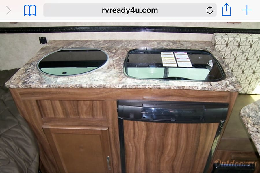 The Viking Los Angeles, California This is a picture of the sink, stove and  refrigerator.