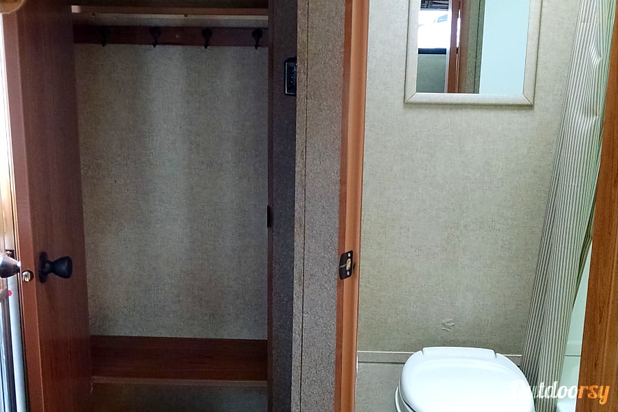 Lightweight for SUVs - Comfortable Camper Littleton, CO Bathroom features a toilet, shower, mirror, sky light and small bath. It is conveniently located​ next to the closet.