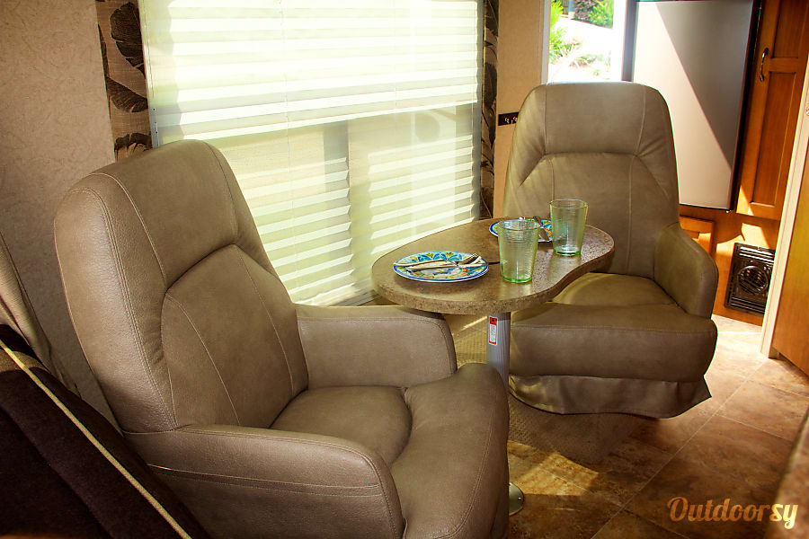 Itty Bitty Betty - Glamping for Two Houston, TX The two swiveling Captain's chairs are a perfect place to sip tea if the weather turns rainy.