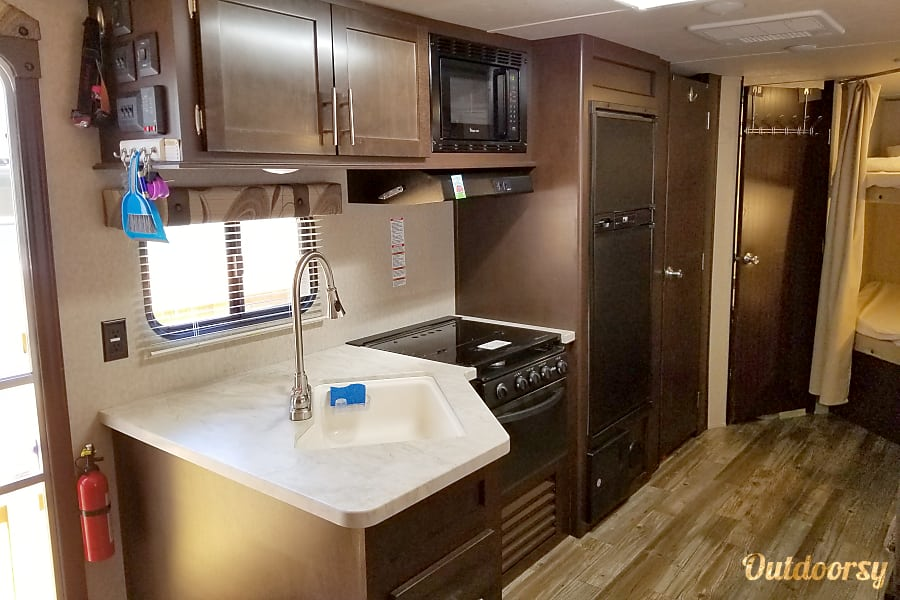 2016 Forest River Cherokee Grey Wolf Jacksonville, FL Fully Equipt Kitchen including pots pans silverware servingware plates cups etc. Fridge runs on gas when driving so stock up and your food will stay cold.