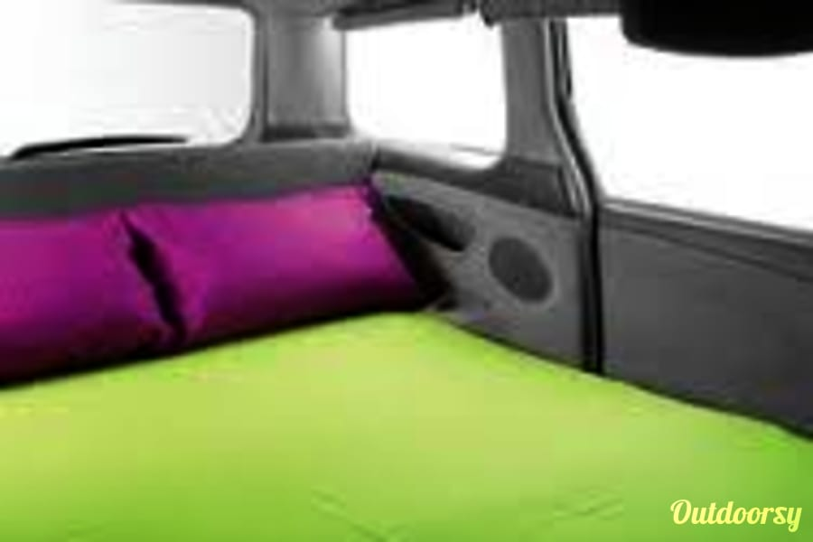 Park Me Anywhere Vancouver, WA Van bed sleeps 2.  Bedding not included but can be requested.