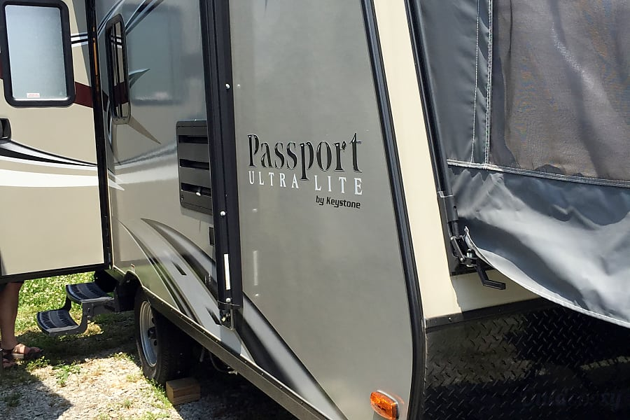 exterior 2015 Keystone Passport 17' Hybrid: Sleeps 5, 3130 Dry Weight: 3500LB Towing Cap Req. Grimes, IA