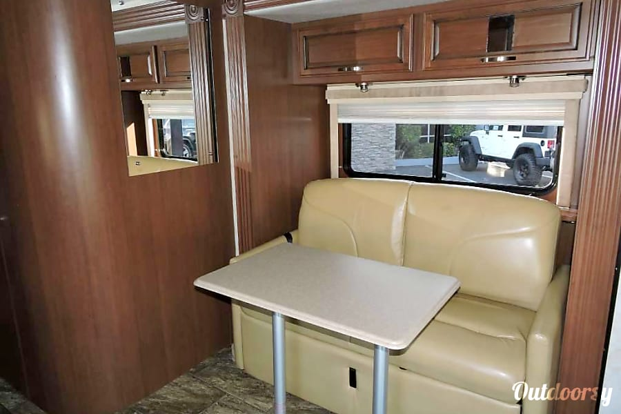 Fleetwood Ranger Class C 25 with 2-Slides and Private Bedroom, Mercedes 188 HP Engine  Sleeps 4 Sacramento, California sofa dinning and both driver chairs swivel