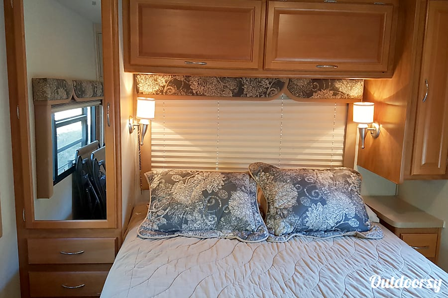 Adventure-ready! Sleeps 8 with Private Master - Fleetwood Jamboree GT 31w El Cajon, CA Master bedroom w/ under-bed storage and cabinets galore.