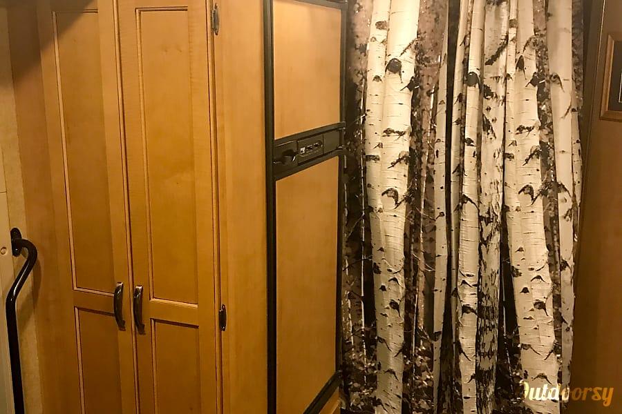 2016 Thor Motor Coach Freedom Elite Layton, UT Large fridge and broom closet. Privacy curtain for master bedroom area.