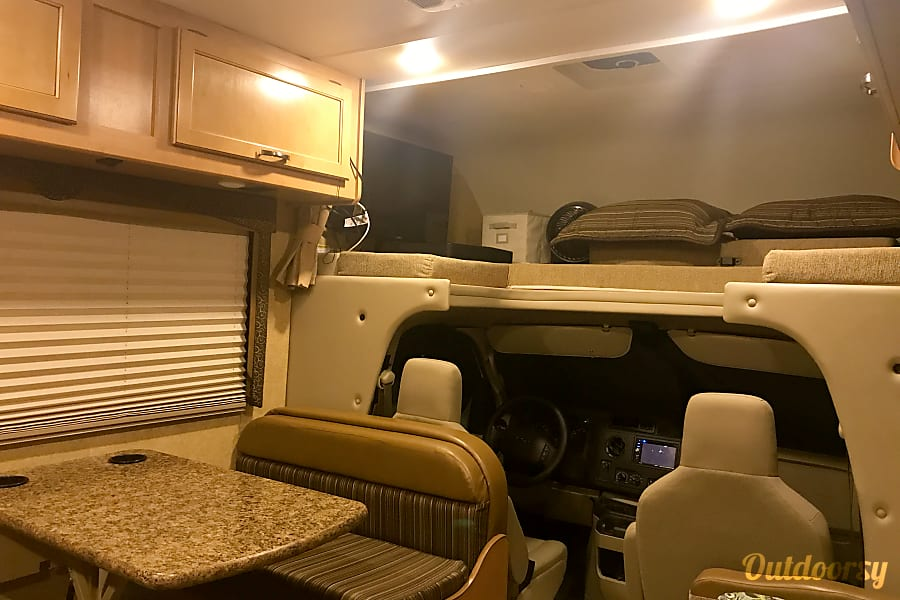 2016 Thor Motor Coach Freedom Elite Layton, UT Queen sized bed above cab with LED TV that swings our for viewing from anywhere in the coach. Blueray player and outdoor antenna. Wired for coupling to cable TV where available. Dinette makes into full sized bed. LED lights throughout for power saving. Double batteries for long lasting power when camping in primitive areas. Built in cummins generator.