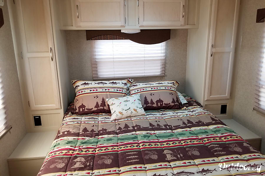 Take the great American road trip in a new 2017 Winnebago! Monument, CO Large bedroom with lots of windows.