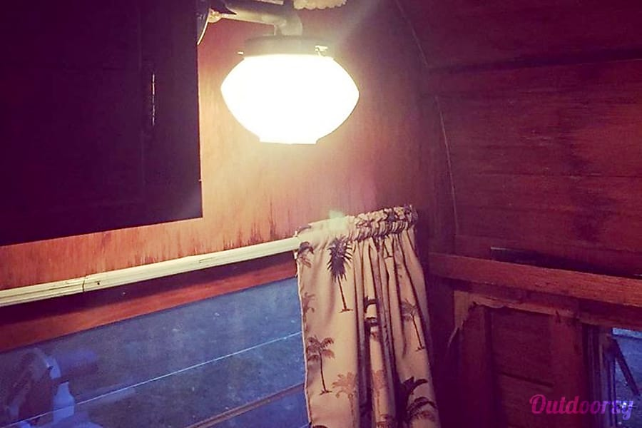 1963 Canned Ham Kansas City, MO Propane lamp but camper also has electric lighting.