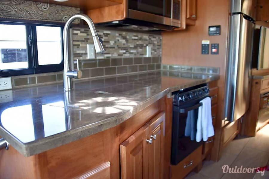 Magic Bus Lake Forest Park, WA The solid kitchen counter tops fit together like a puzzle leaving a flat surface owner the sink and stove.