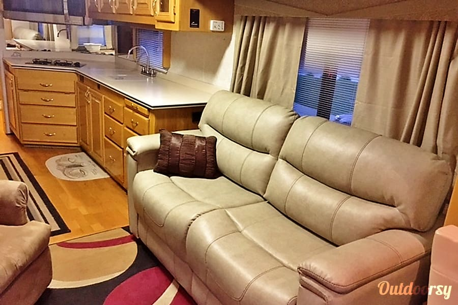 2000 Beaver Contessa 40' Englewood, Colorado Our brand new Tri-fold couch makes into a great bed for two. Lay in bed and watch TV or your favorite music.
