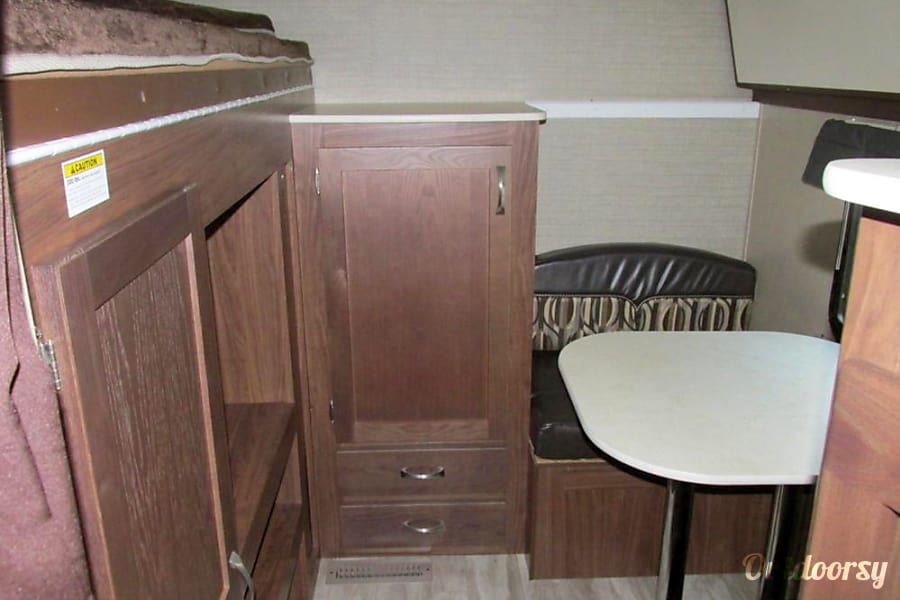Family Friendly Value 2014 Aerolite Travel Trailer Pearland, Texas Bunk area with a small dinette across from tv/game hookup where kids can hang out. Dinette converts to a twin bunk.  This can be a private room also
