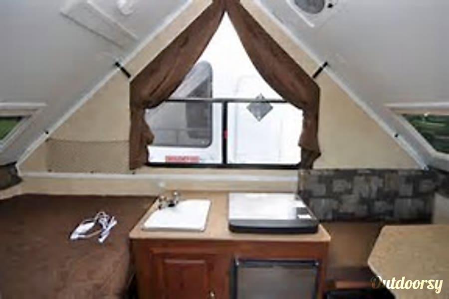 Fully stocked, compact, light, super fast set up! Boise, Idaho Includes sink, 3 burner stove, frig (under stove), storage (under sink.)