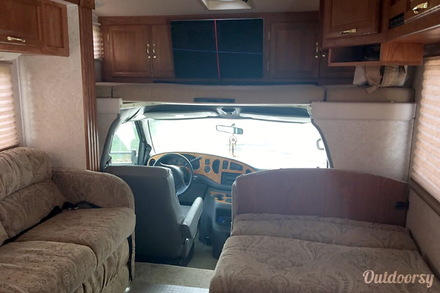 2003 Ford Coachman Wauwatosa, Wisconsin Bed over the driver front, kitchen table fold into a bed as well as the sofa. Sony tv with satellite and antenna.