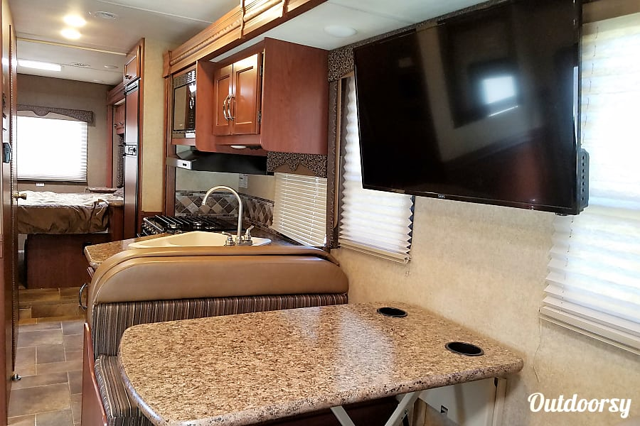2016 Thor Motor Coach Freedom Elite Sudbury, Vermont Interior view, looking towards the bedroom, with slide out stored, ready for travel.