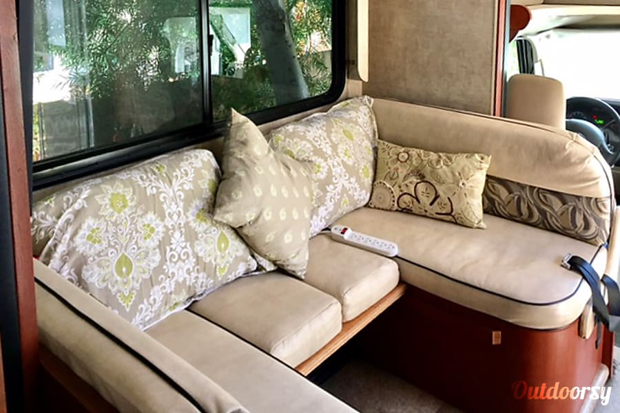 """Miss Minnie Ripon, CA This dining/sofa area slides out.  It makes a bed for someone 5'8"""" or less. This can be configured as a large dining table with facing seats only."""