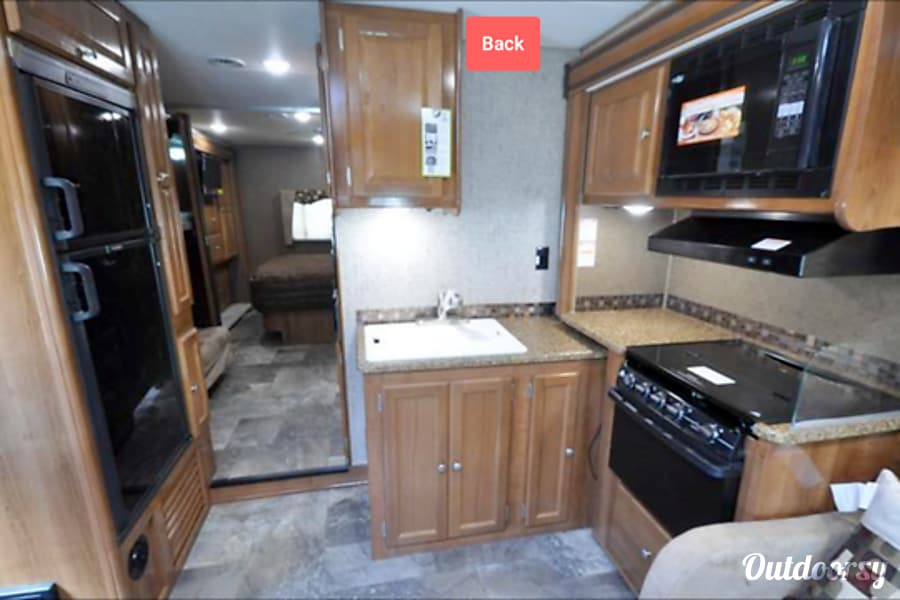 2018 Coachmen Leprechaun Canton, TX View to back through kitchen and bunk hallway