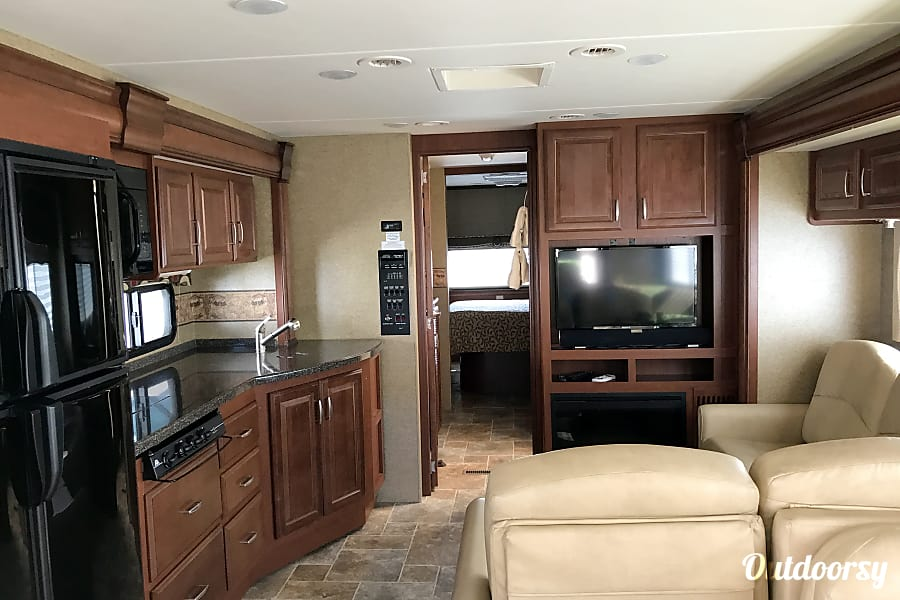 2014 Thor Motor Coach Challenger Secret Garden Henderson, Nevada Large Kitchen /Entertainment Area. Fireplace/TV with Sound bar for the perfect Entertainment Big Enough to Entertain and Enjoy
