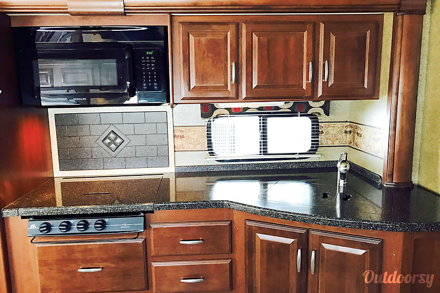 2014 Thor Motor Coach Challenger Secret Garden Henderson, Nevada A gourmet's dream Large gas stove, microwave and huge double sink, granite counter top and back splash
