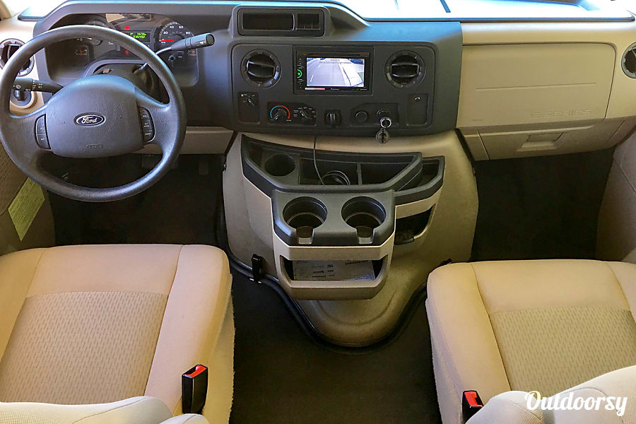 Miss Minnie Ripon, CA Cockpit with backup camera shown on the screen. Automatic with cruise control. There is a cab over loft above with king size bed.