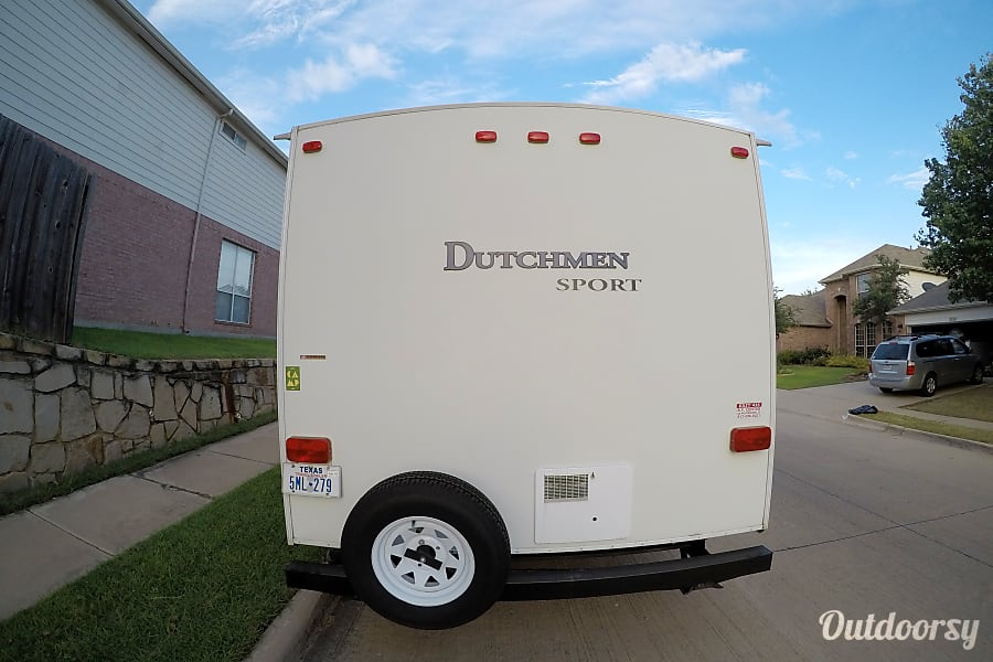 2010 Dutchmen Sport 27B Bedford, Texas New spare tire, the bumper carries the sewer hose.