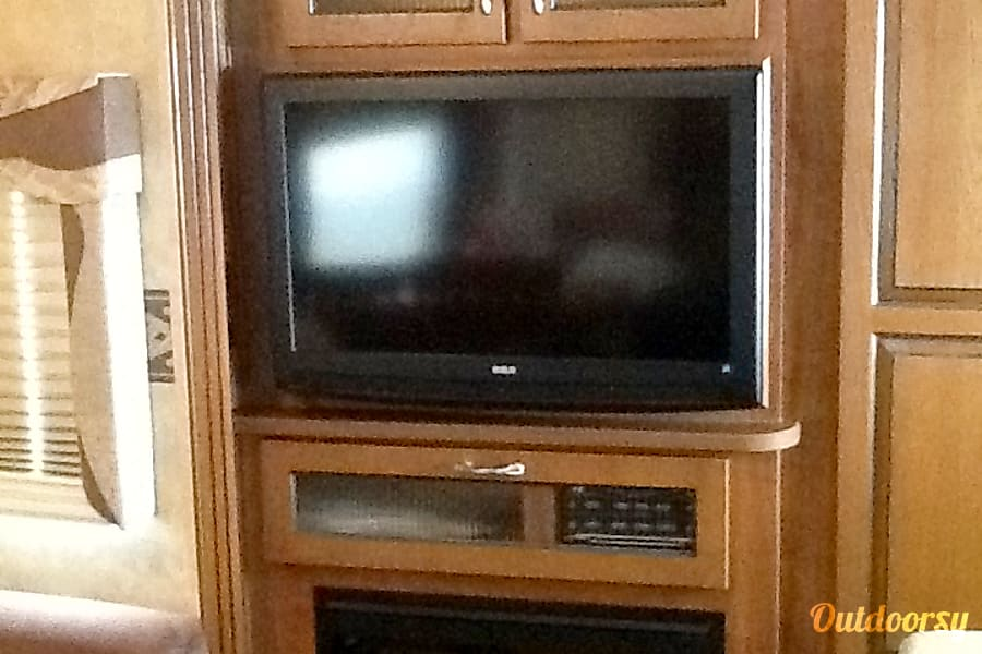 WILL DELIVER & SET UP! Madill, Oklahoma TV, stereo and fireplace in living room
