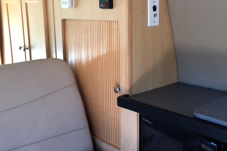 2011 Pleasure Way Traverse Santa Rosa, California Rear seating for 2 with seat belts that fold down to bed, pantry and microwave (pictured).