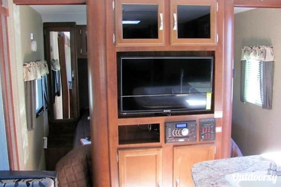 2017 Keystone Passport 2400BH Grand Touring Cedar Park, Texas View of TV and sliding bedroom doorways