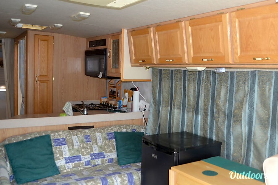 1997 Rexhall Aerbus Colorado Springs, CO Sitting area looking into kitchenette.