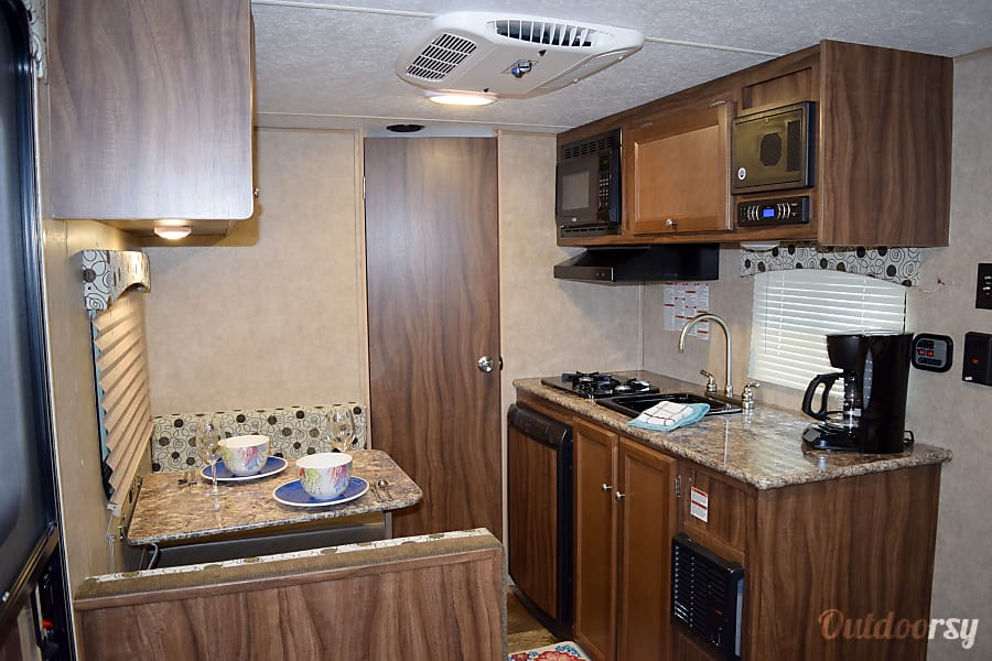 """2017 Coachmen Clipper (17') - nicknamed """"Bandera"""" Houston, TX The kitchen offers a refrigerator, two-burner stove, microwave, coffee pot, sink & comes stocked with all the basics."""