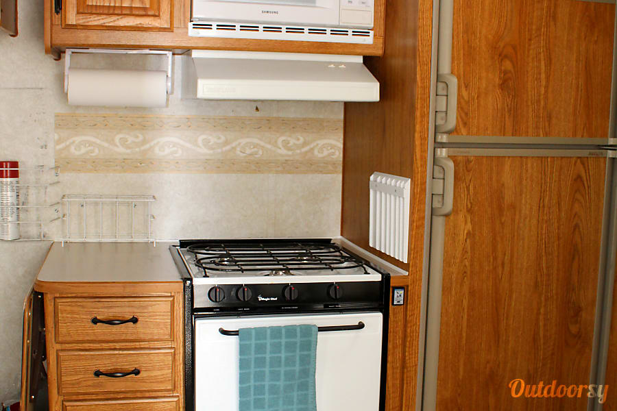 2002 Terry 26' ToyHauler Clearfield, Utah gas stove and oven, microwave and fridge and freezer that keep food nice and cold!