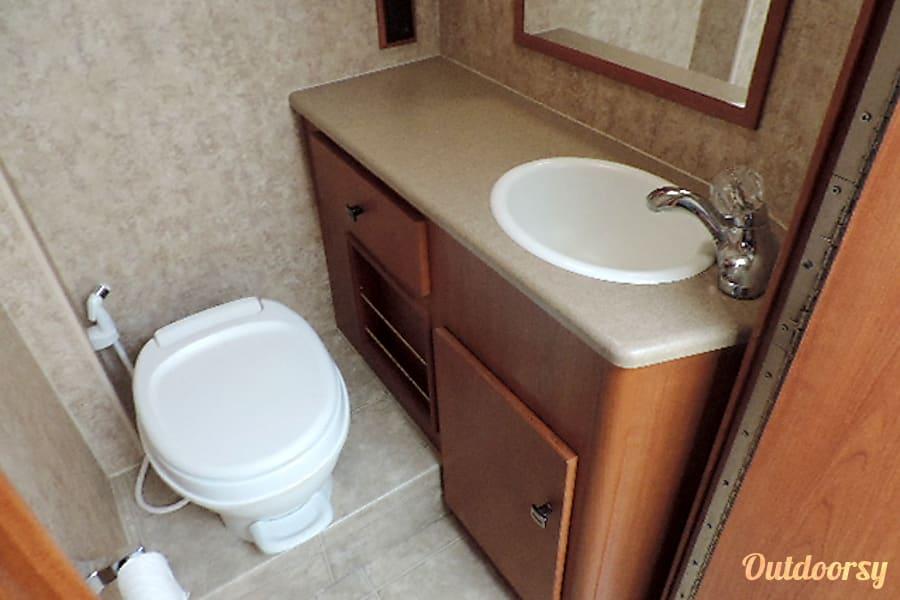 2007 Winnebago Outlook Tallahassee, Florida Roomy bath area, bathroom countertop with drawer and storage underneath.