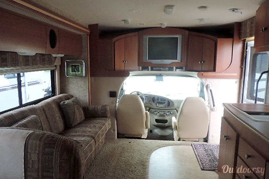 2007 Winnebago Outlook Tallahassee, Florida Over the cab, a big entertainment unit with built in speakers in the living area.