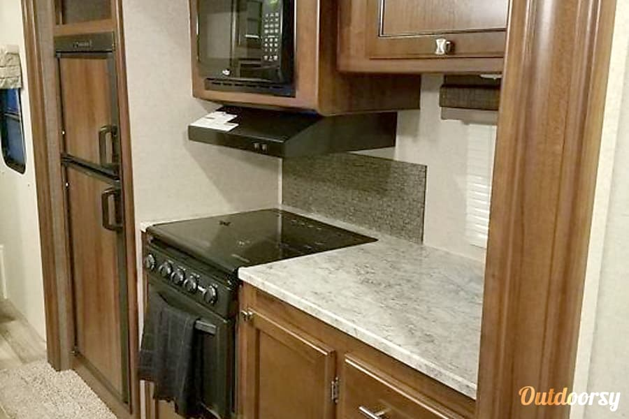 2017 Heartland North Trail 23 RBS Tigard, OR Range, oven and fridge with more counter space with more storage