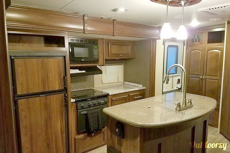 2017 Heartland North Trail 23 RBS Tigard, Oregon Kitchen and Island with double sink and lots of counter space.