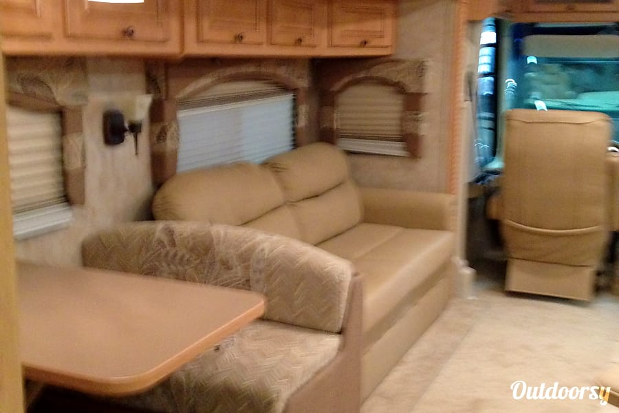 The Damon Charlotte, North Carolina The Queen Size sleeper sofa makes into an immediate automatic inflatable bed.  There is a drawer underneath that stores blankets, Sofa Throws, Sofa Pillows, Table Cloths, etc.  All for you to use at no charge.
