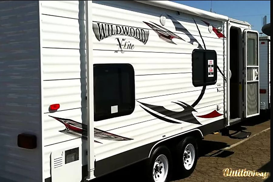 2013 Forest River Wildwood X-Lite Alpine, California Side view shows Entry and Awning - with outside speakers
