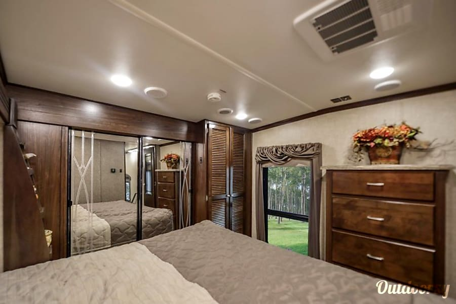 We deliver and pick up! You just show up and relax- 2017 41' Gateway Ocala, Florida Relaxing master bedroom with a spacious closet, washer and dryer, dresser and beautiful big window.