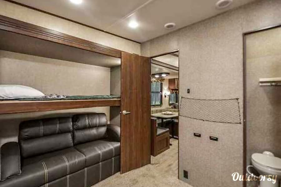 We deliver and pick up! You just show up and relax- 2017 41' Gateway Ocala, Florida Another view of the bunk room, and half bath.