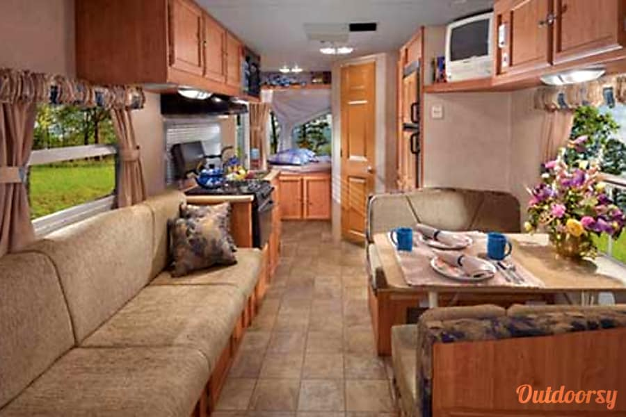 Adventurer - Hybrid Forest River Shamrock Minneapolis, Minnesota This is a manufacturers photo and represents the interior with full lighting. NOTE! This RV has no TV. You can hook-up your laptop or other device into the stereo system.