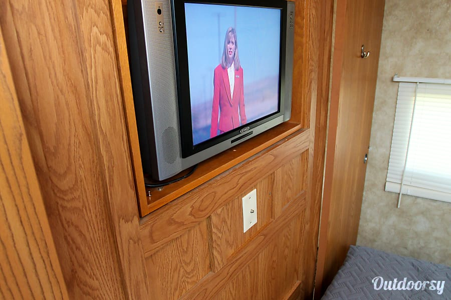 2004 Keystone Sprinter Plantersville, Texas Reversible TV/Mirror and the slider doors in the Master bedroom allows you to watch discretely while reclining in the master bedroom.