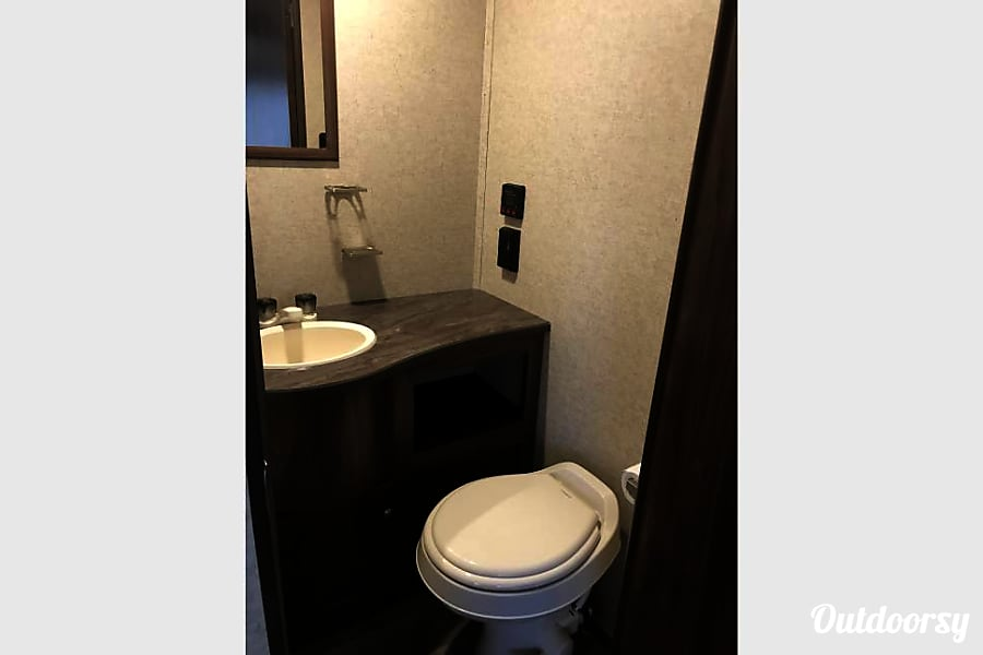 2018 Heartland Prowler Lynx San Antonio, TX Bathroom comes stoked with RV friendly toilet paper, hand soap, hand towel, and towels.