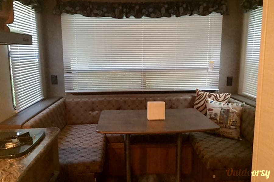 2016 Keystone Springdale Newport News, Virginia Here is the kitchen table, with a three side view of the outdoors, if you choose to open the shades.