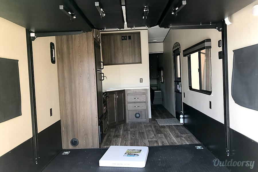 2018 Riverside Rv Rpm Denver, Indiana Beds raised up to fit the Harley's in