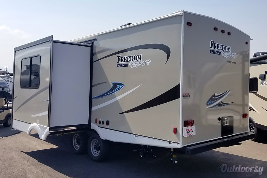 "2018 Coachmen Freedom Express 25SE Herriman, UT Back showing the 36"" slide out."